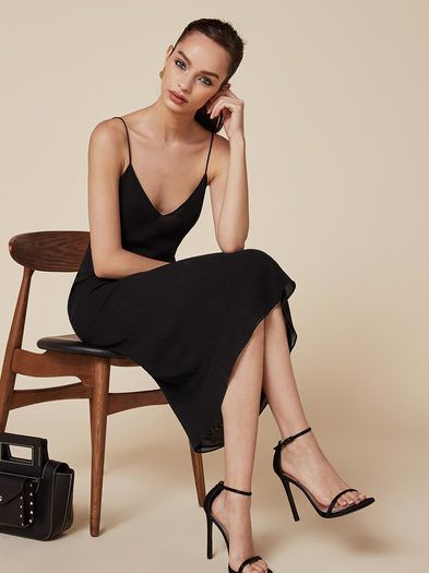 Make it look easy. This is an ankle length dress with a v neck, spaghetti straps and low back.