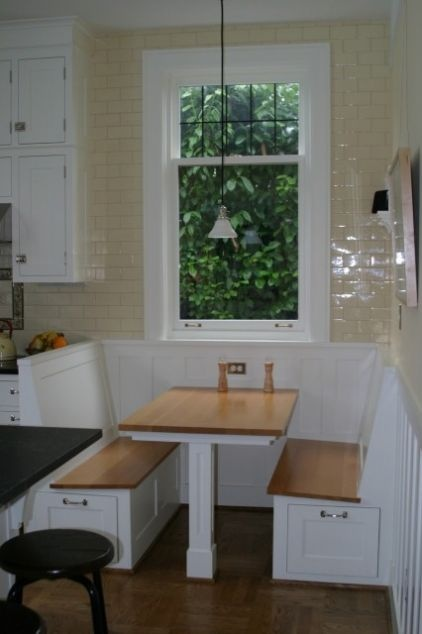 drawers built into breakfast nook seating - it's like having a diner in your kitchen  Drawers are a good idea not sure about the style though.