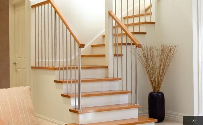 Wooden treads on white stairs
