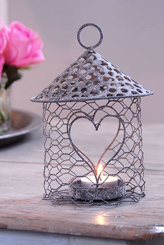 Wire tealight holders. I don't know where to get them or how to make, but these are super cute!