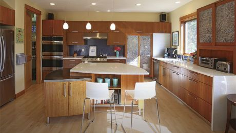 This remodeled kitchen, by Richard Shugar of 2Form Architecture, features custom cabinets, a curvy island, and unique materials.