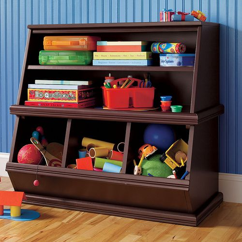 The storage unit from Land of Nod is perfect for Solomon's books and toys! Also, it's nice enough to put in the living room