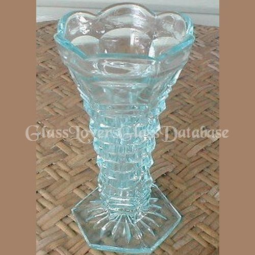 Series 65 aka Brickwall No. 6584 Vase by Crown Crystal Glass Co Ltd, Australia Series 65 vase, No. 6584. Stands 6 inches tall. There were 4 different style vases in this series . A rose bowl, No.6586; a 9 inch high no.6582 vase and 2 different styles vases measuring 6 inches high, both No. 6584. This one is in Crown Crystal blue glass. Blue being one of the harder colours to find. Also known as Brickwall.