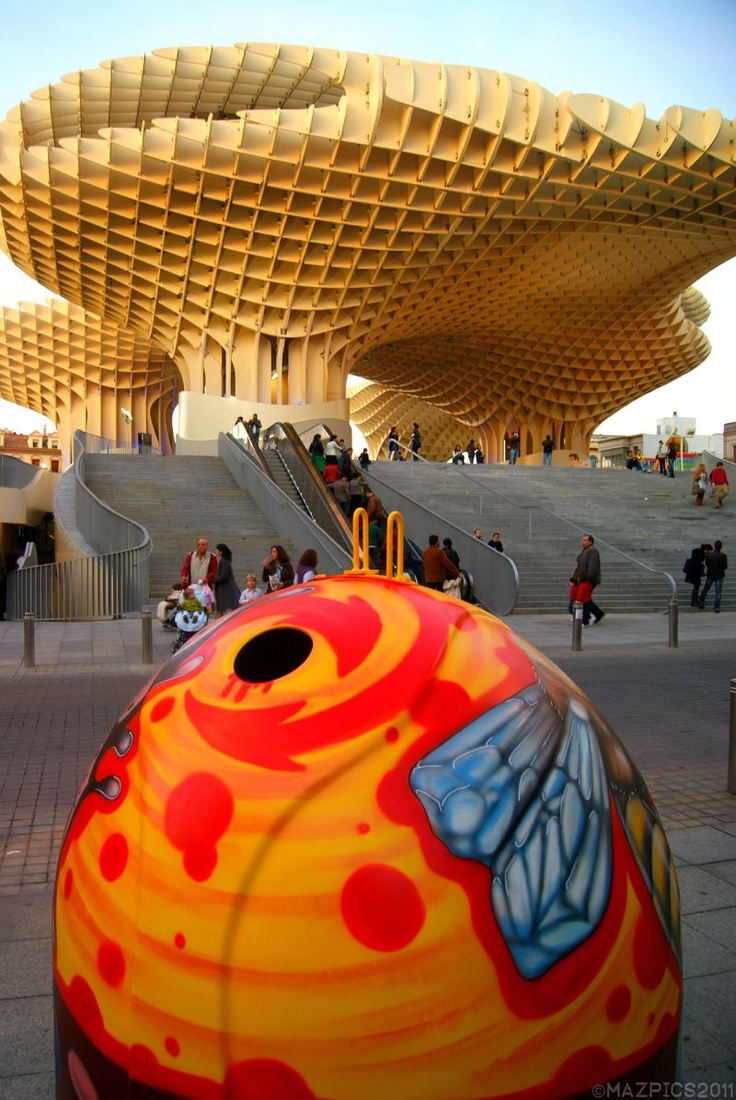 Metropol Parasol (and a painted bin in the foreground.) This is one of the most unusual buildings I've ever seen - Seville, Andalusia, Spain. copyright mazpics 2011