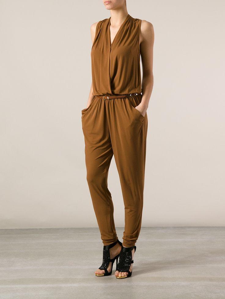 Shop this look on Lookastic: https://lookastic.com/women/looks/brown-jumpsuit-black-sequin-heeled-sandals-brown-leather-belt/22897   — Brown Jumpsuit  — Brown Leather Belt  — Black Sequin Heeled Sandals