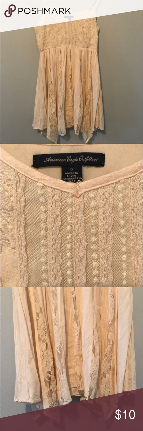 NEW LISTING***American Eagle Cream Lace Dress Lovely cream lace dress, fully lined, from American Eagle. Only worn a couple times but it does have two small stains and a small hole in part of the lace on front. All are minor and barely noticeable. You may be able to treat stains and remove all together. Perfect for all your summer concerts, festivals and fun! Approx. 14inch waist and 25 inches in length. Good condition! American Eagle Outfitters Dresses