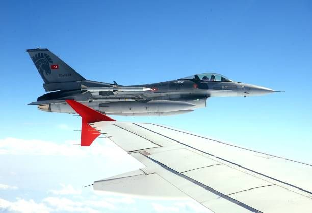 An F16 fighter jet is seen from President of Turkey Recep Tayyip Erdogan's official plane during his air travel to attend events of the 1st year...