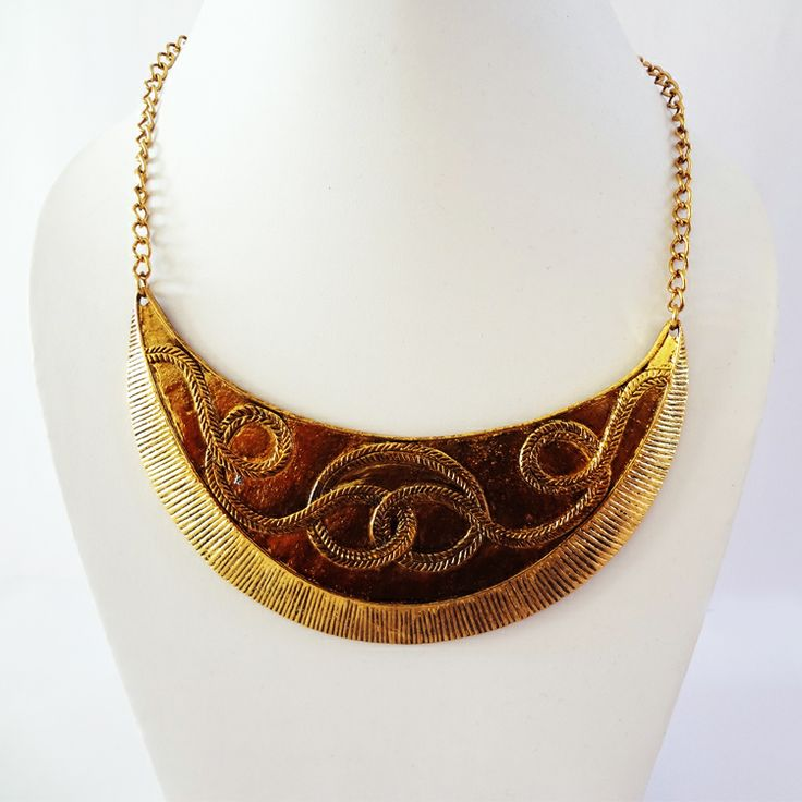 Brass crescent shaped necklace by Chobhi