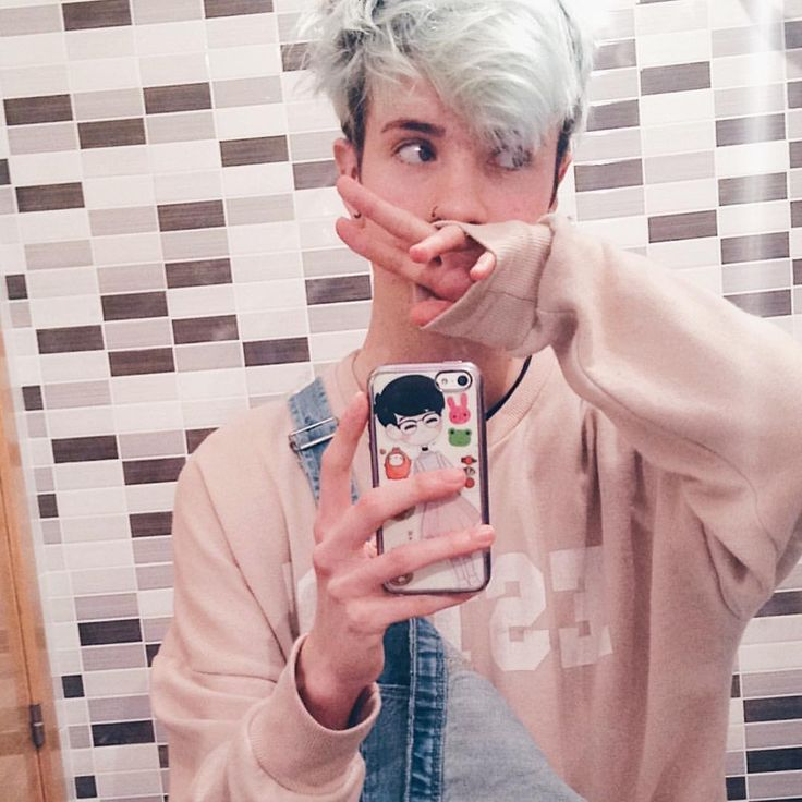 Androgynous pastel blue green hair boy fashion overalls sweater