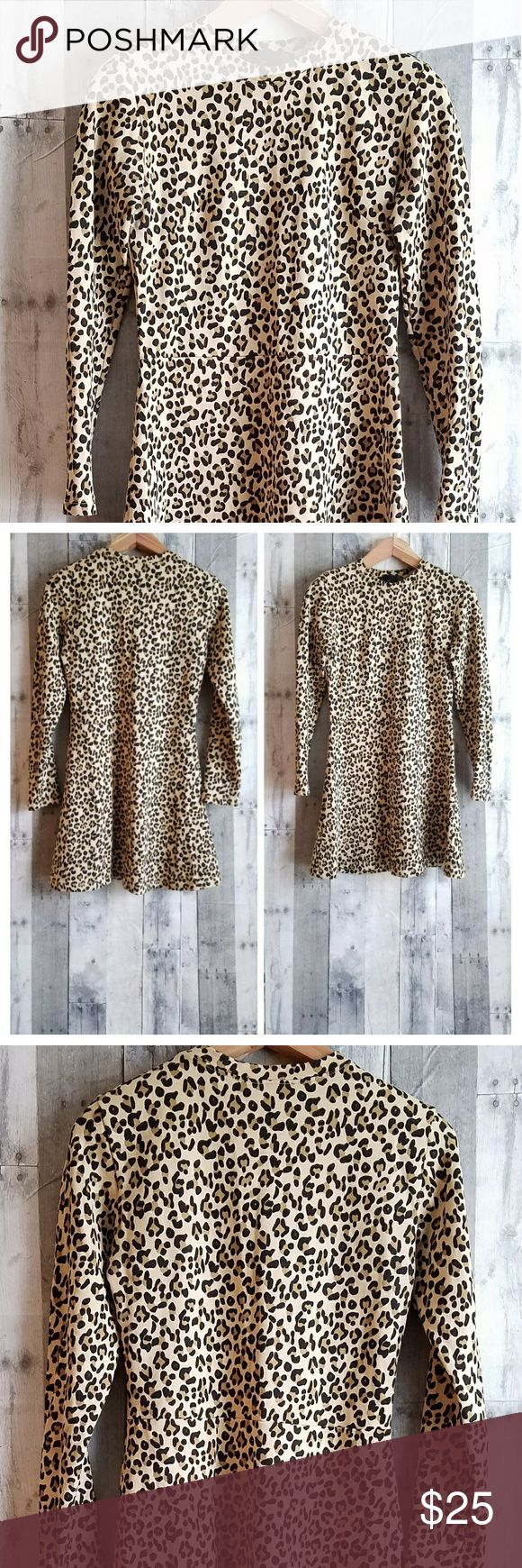 "🍍EUC TRF BY ZARA animal print long sleeved dress EUC TRF BY ZARA animal print long sleeved fit amd flare dress. 100% cotton. The measurements are as follows- Shoulder to shoulder- 16 1/2"" Armpit to armpit- 17 1/2"" Bust- 34"" Waist- 30"" Hips- 42"" Length- 34"" Sleeve length- 24"" Zara Dresses Long Sleeve"