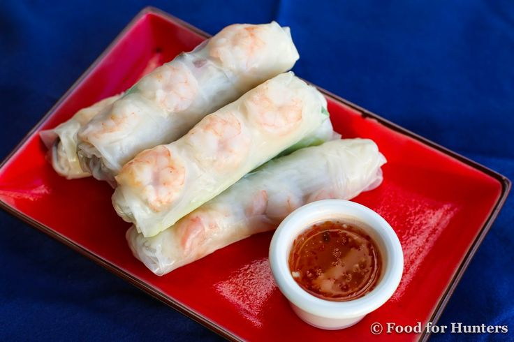 Traditional Vietnamese Spring Rolls filled with venison, shrimp, mint, crunchy cucumber and rice noodles, served with a citrusy, spicy and salty sauce.