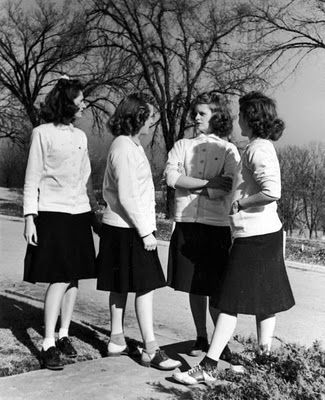"""""""Four members of the Gamma Phi Beta sorority wearing white sweatshirt cardigans, this year's fashion fad among fellow sisters on the campus at the Univ. of Kansas."""" LOL. Whenever you're sick of trends, just look at this picture. At least it's not this bad. 1939."""