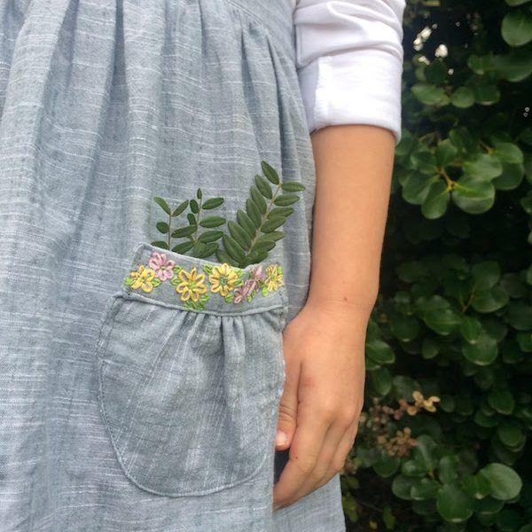 The Tui Pinafore PDF sewing pattern  by Below The Kōwhai $14 in sizes 1-10 - it comes with this sweet embroidery pattern and tutorial.