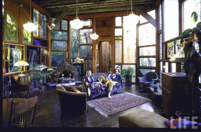 1970s home of John Holmes, made from reclaimed & salvaged materials.  Love all those windows!