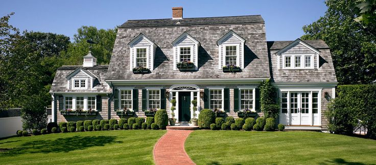 Dutch colonial with boxwoods and window boxes