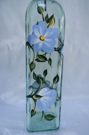 Botella de aceite botella de aceite con flores de color azul