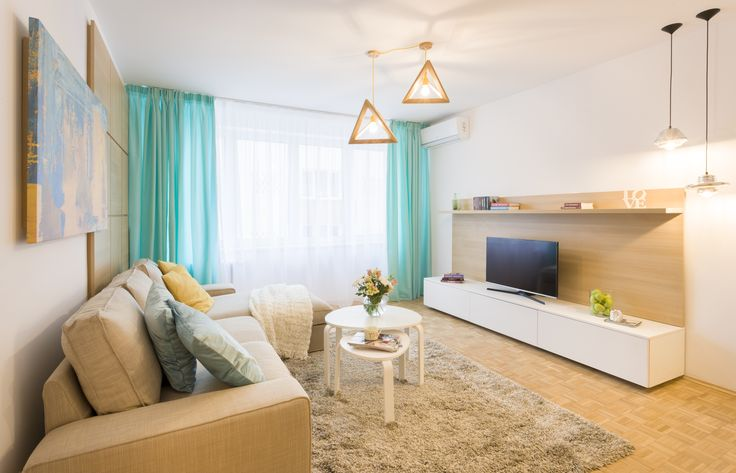 A great room in Bucharest, with turquoise accents and printed canvas painting, with modern furniture and vintage floor.