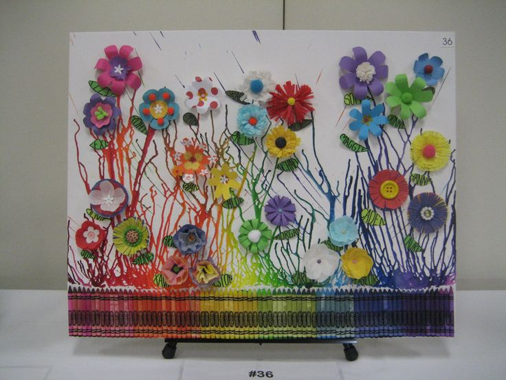 Crayon art with various paper flowers made by the children.