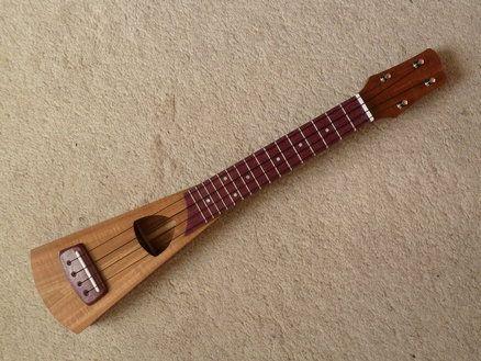 Koa Travel Concert Ukulele. whoa...looks kind of like the one I just built. Even the sound hole, but rotated...