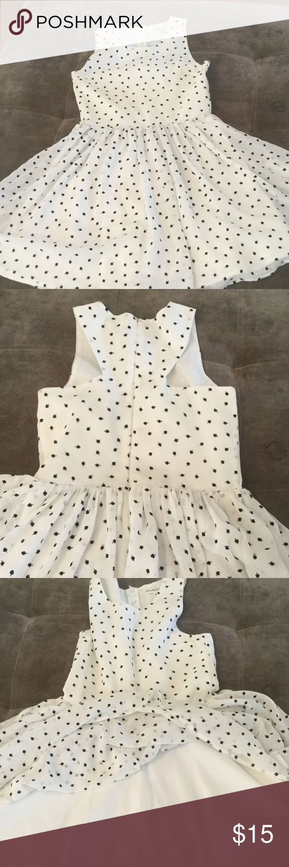 Girls Miss Behave Dress Size M Sweet like new dress perfect for Spring and Summer.  Size M.  Sizing is like 8-10.  Is fully lined and has a thin poly shell which makes the dress so delicate looking.  It has sort of a racer back cut and zipper back.  No stains or tears. Miss Behave Dresses