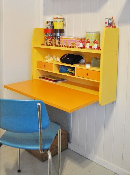 Yellow hanging / wall desk - perfect for small kids room. Maybe a white board on the front?