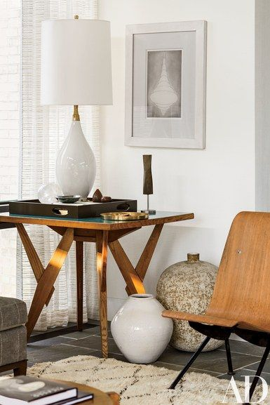 A small Noguchi sculpture stands on a living room side table in this home in Bridgehampton, New York | archdigest.com
