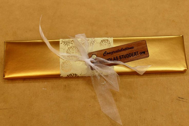 Choose gift wrapping for a personalised gift with engraved wooden gift tag