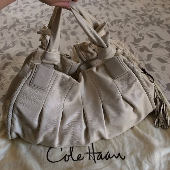 "Authentic Cole Haan leather cream purse! Authentic Cole Haan cream leather purse! This purse is in great condition and holds a ton!! The inside is in excellent condition! No stains, rips, etc. The outside is in great condition only showing a few minor marks (about 3 marks in total, each only the size of a small dot). Purse is approx. 17"" L x 12"" H x 5"" W. Comes with storage bag. Cole Haan Bags"