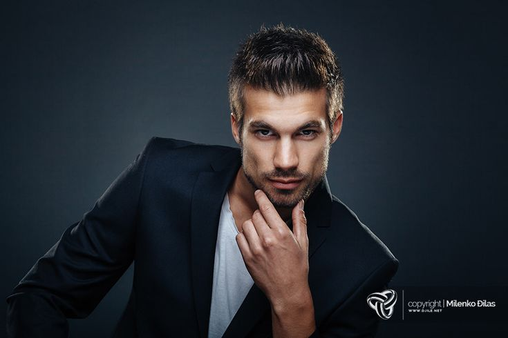 Man's beauty - Portrait of handsome man in a studio on a dark background