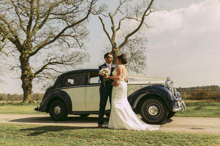 The newlyweds with their classic car. Photo by Benjamin Stuart Photography #weddingphotography #weddingcar #justmarried #couplephoto #wedding