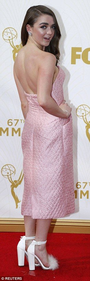 Pretty in pink: Maisie showed off the backless dress on the red carpet