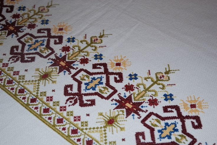 Cherished Wonderful tablecloth, embroidered carefully by hand, cross stitch, in a Cretan pattern (design from traditional Cretan sheet edging) on cotton fabric itamin.  This piece is a labour of love and took many many hours to complete.  Ideal for festive tables, special events, Thanksgiving, Christmas or New Year's Eve. An excellent gift for weddings.  Excellent quality, made with care and special technique. Dimensions are 220 X 200. Suitable for a table of 8 seats.  Machine washable…