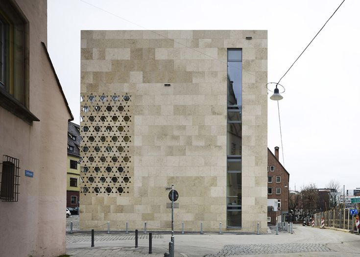Synagogue in Ulm, Germany, with windows shaped like Star of David symbols in the limestone walls by Kister Scheithauer Gross.