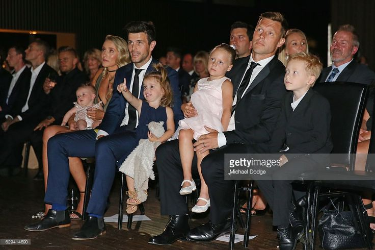 Sam Mitchell (R) of the West Coast Eagles (formerly of the Hawthorn Hawks) and Trent Cotchin of the Richmond Tigers with their kids during the 2012 Brownlow Medal presentation on December 13, 2016 in Melbourne, Australia.