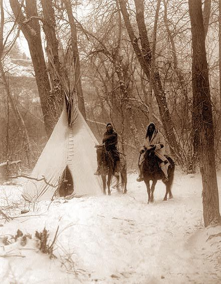 You are viewing an original photograph of a Tipi in the Snow. The photo was taken by Curtis in 1908. The picture shows two men on horseback in front of a Tipi.