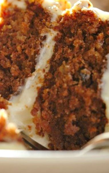 Carrot Cake Recipe ~ Says: a super yummy, low calorie version of a homemade carrot cake. Considering that traditional carrot cakes can average 12-15 weight watchers points per serving, this diet friendly carrot cake recipe is a fabulous bargain at just a 4 Point Total per serving. Much lower in points and yet still tastes AMAZING. This is not an official weight watchers dessert recipe, it's a great, low calorie dessert that will satisfy the carrot cake lover in everyone.