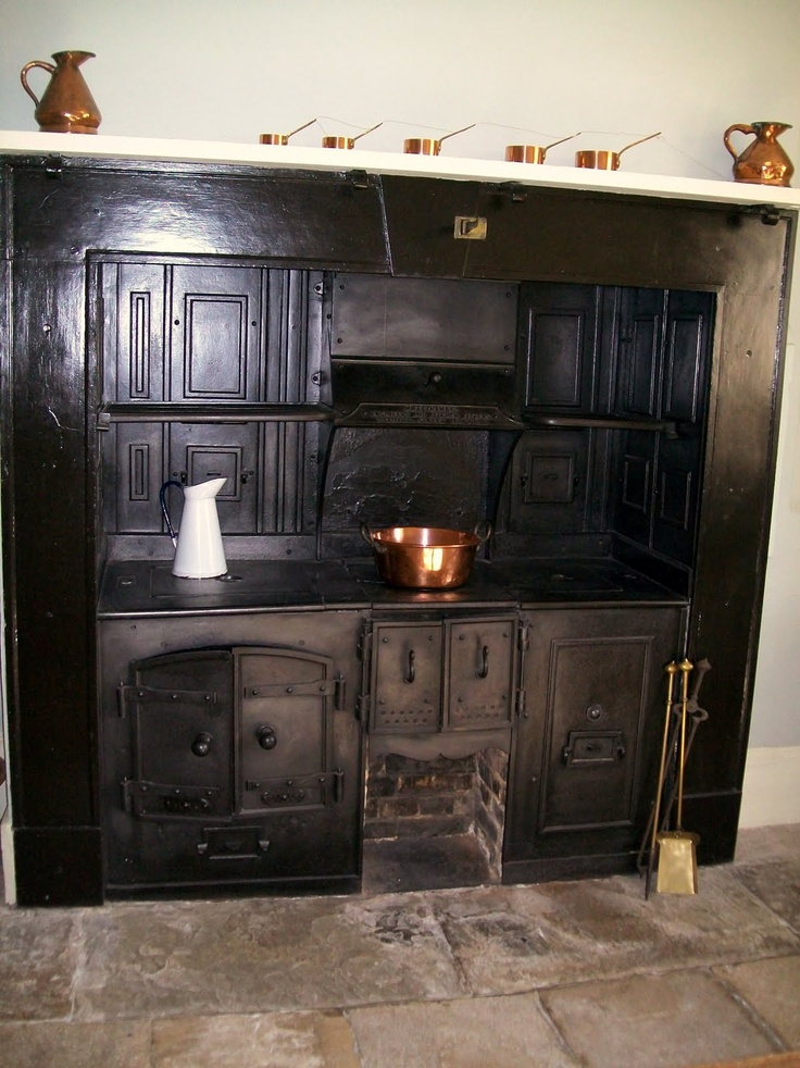 The kitchen with its iron solid fuel range and flagstone floor.