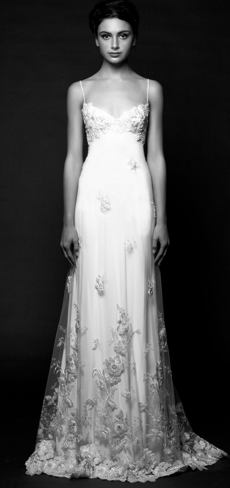 Daphne-<p>Shimmering with a beaded and embroidered botanical motif, this matte silk satin wedding gown overlaid in breezy tulle implies a perennial spring.  Anchored by fine rouleaux straps, Daphne's low sweetheart bodice and angled empire line create an alluring décolletage. The generous bias-cut skims the waist, flows over the hip and falls into a fluid A-line skirt. Available with cap sleeves.</p>
