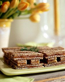 Assemble smoked-salmon tea sandwiches with herb butter on grain bread a day in advance, and cut before guests arrive.