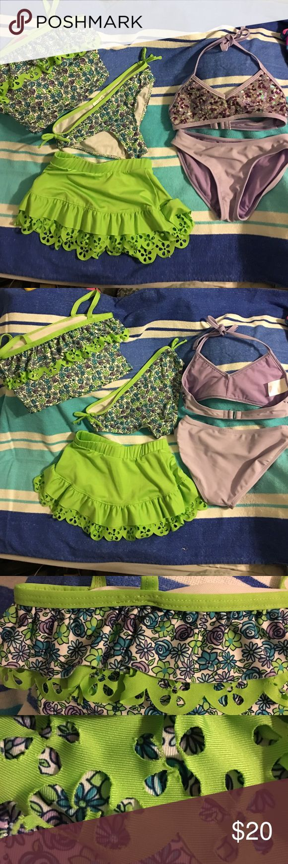 Girls 2 piece swim suit & skirt coverup lot 6-6X Suit #1 lavender Xhilaration bikini with purple and silver sequins. Ties behind neck, plastic hook in back. Includes matching bottom. In very good condition. #2 pull on style tankini in white, lime, blue, and lavender flower design with spaghetti straps by Penny M. Matching bottom with decorative bows on sides and lime green skirt coverup with flower cut outs on ruffles. Some cutouts on the top are torn. It is not noticeable and mostly covered…