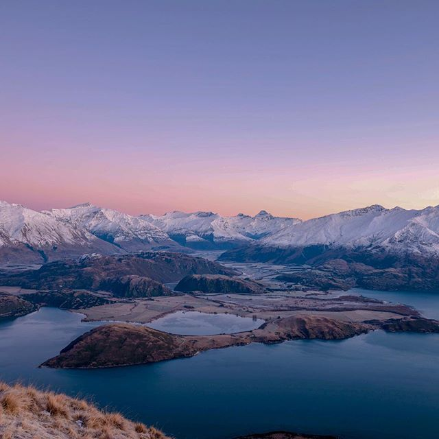 Wanaka, New Zealand. We spent the night climbing the mountain, one step forward three steps back due to the ice and snow that hampered our trek to the summit but we persevered and eventually we made it. It was a moment when you truly are on top of the world.
