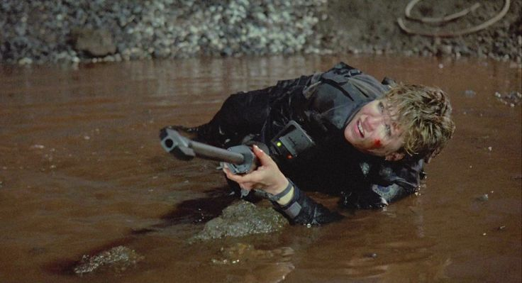 RoboCop 1987 Anne Lewis (Nancy Allen) obtains one of the Cobra Assault Cannon rifles and uses it against Leon Nash (Ray Wise) during the shootout at the abandoned steel mill.