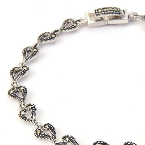Dainty marcasite studded hearts are linked together to create a beautiful piece of jewellery.