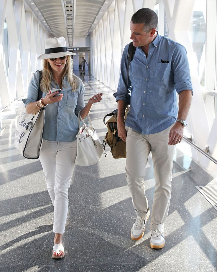 Reese Witherspoon and Jim Toth landed at the airport in Boston on Friday, and the duo looked more than ready for a couple's getaway — in fact, they were so in sync, their outfits matched perfectly!