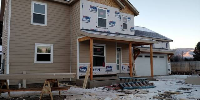 Construction Is Underway Kitchen Cabinets Being Installed Custom 2 Story 4 Bedroom 2 1 2 Half Bathroom Home With Main Floor Missoula Water Wheel Property