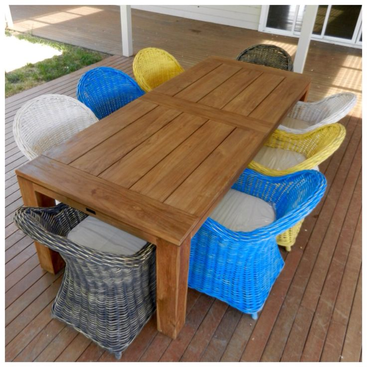 Teak outdoor furniture, dining table with Roma chairs.