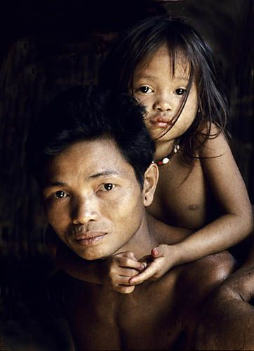 Indonesia. Borneo rain forest. Dyak man and daughter.