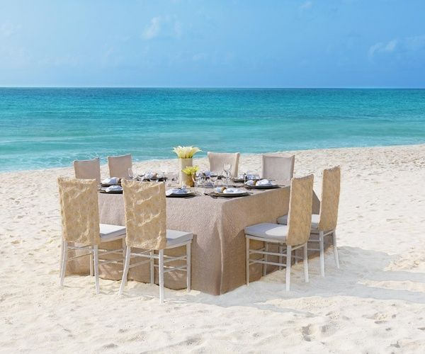 Natural linen table cloth and chairs for beach wedding reception | Pearl Shimmer Collection at Palace Resorts #destinationwedding