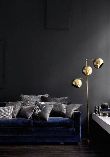 Normally i like black walls but with this navy sofa it would be too dark in daves home i like the blue sofa with grey and brass accents