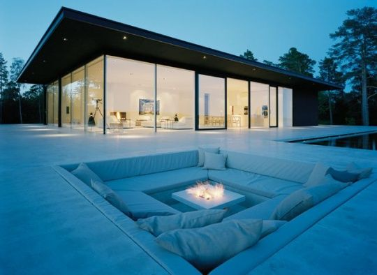 I'm not a big fan with the glass house, but the recessed outdoor seating with a fire pit is another story!